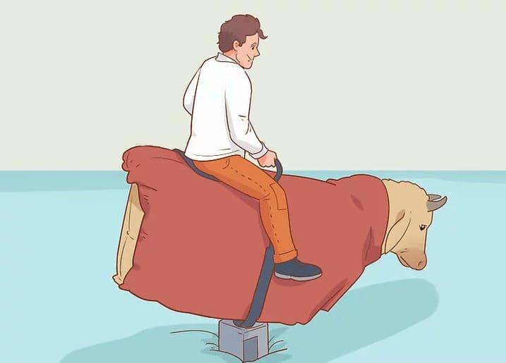 Como no caerse de un toro mecánico para fiestas